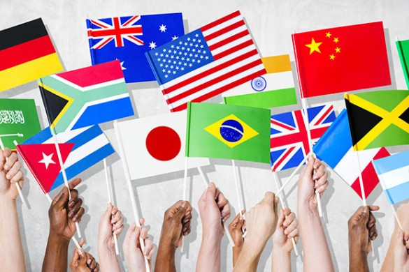 Group Of Hands Holding National Flags